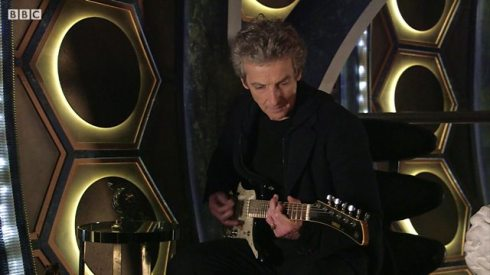 Twelfth Doctor with guitar
